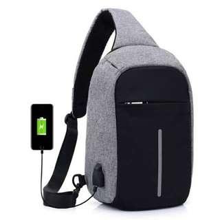 Tas Anti Maling sling bag USB ( ada resleting )