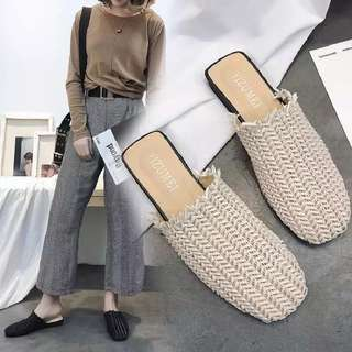 2018 spring and summer new Muller slippers simple temperament woven round baotou slippers women can wear flat shoes