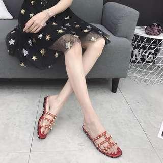 Rivets decorate sandal