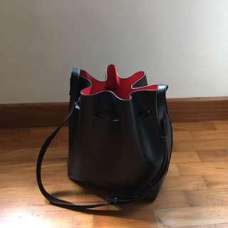 Black red bucket bag