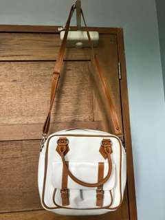 Brown and white sling bag