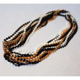 VINTAGE 60s 7STRAND NECKLACE                           US Faceted Plastic Bead