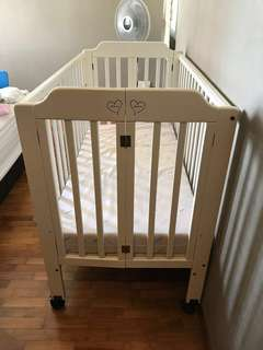 Baby One Baby Cot from Spring Maternity + Free Baby Diaper bag