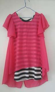 Short pink dressbwith inner black and white stripe