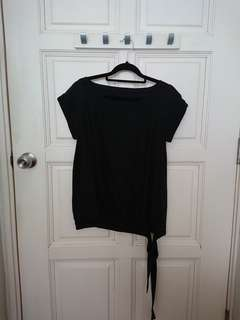 Black boat neck blouse with tie waist