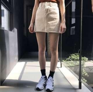 杏色牛仔A字短裙