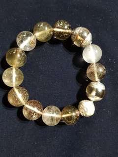 12mm Smokey Quarzt Bracelet strung with 925 Silver beads.