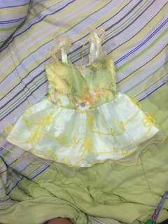 Yellow baby dress with floral motifs