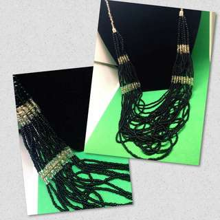 Multiple layer long beaded necklace