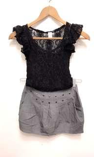 黑色蕾絲氣質上衣+卯釘灰色短裙。贈送內搭小可愛一件!