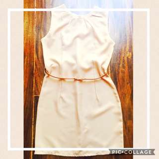 Nude color knee length dress with belt