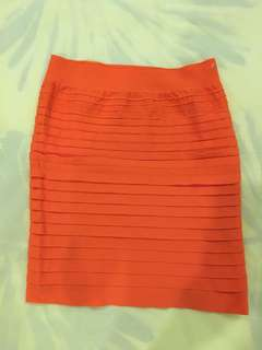 Orange bodycon mini skirt