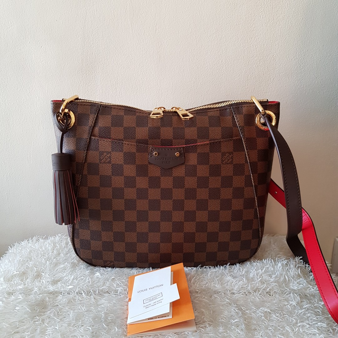 8be499b013cb Authentic Louis Vuitton South Bank Besace Crossbody Bag