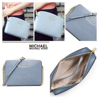 Michael Kors Jet Set Travel Large East West Crossbody in pale blue color  P6500  New with tag  Product Overview Keep your essentials organized with the classy Jet Set Travel Large crossbody