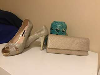 Almost new high heels size 7.5 with the clutch