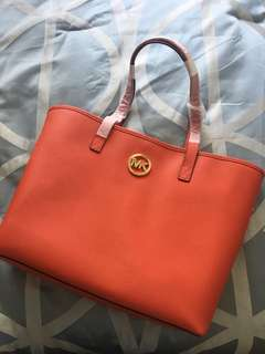 "Genuine Michael Kors ""JET SET TRAVEL"" bag. Mandarin, leather."