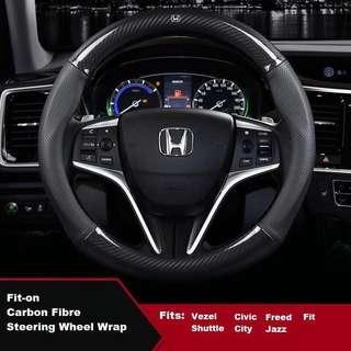 Carbon fiber steering wheel wrap