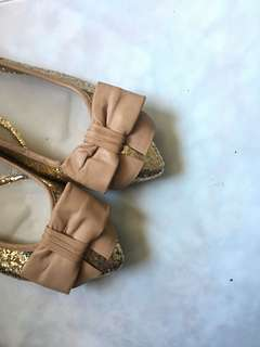 Gold sparkly flats with pink ribbon