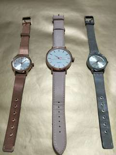 Silver, rose gold and pink watches