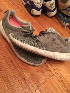 Well worn Nike Roshe. Size 10.5 US