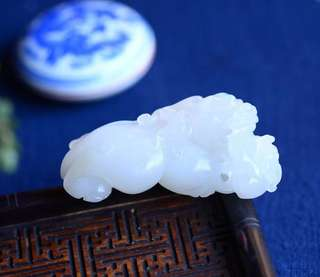 The fine natural and tian jade white jade [generation of wealth] double pixiu.