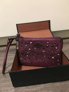 exclusive sold out coach wristlet