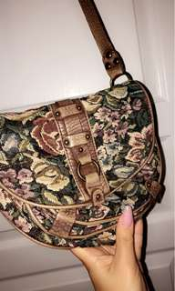 Over the shoulder woven floral purse