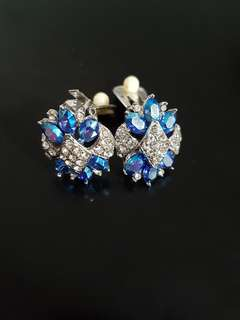 Affordable clip-on earrings adorned with silver crystal settings and blue faux gemstones! Great as a mother's day gift