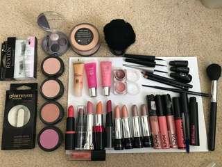 Assorted makeup - lipstick, lip gloss, blush, eyeliner, eyelashes, eyeshadow, mineral powder, mascara, brushes