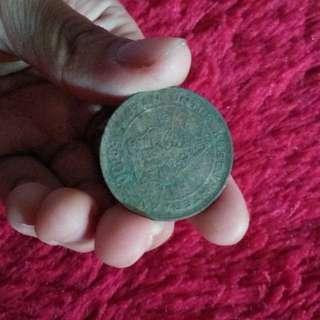Uang 100 rupiah wayang gunungan
