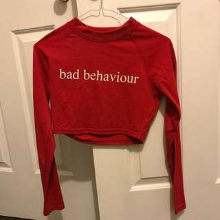 Bad Behaviour slogan crop top