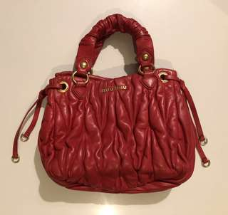 Authentic Miu Miu red leather handbag gold tone