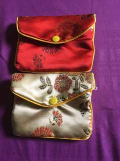 Two brand new pouches