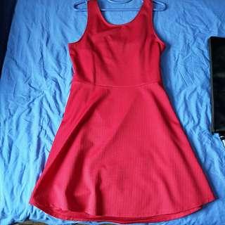 Red sleeveless jersey dress