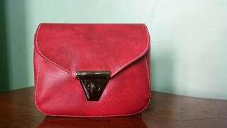 V Shape Lock Red Sling Bag