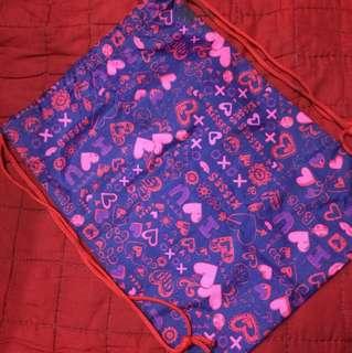 Purple string bag
