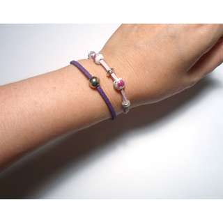 handmade lila and violet bracelet with ceramic beads and silver charm