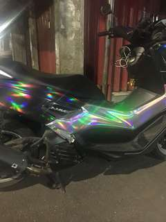 HOLOGRAPHIC STICKER.