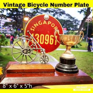 Rare Vintage Local Bicycle Metal Number plate on a wooden stand with a Little Antique Bicycle and Silver-Plated Trophy. Good Condition. $128, sms 96337309.