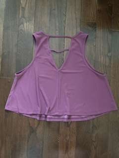 Dark pink cropped tank top with triangle cut outs