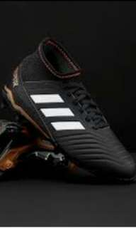 Authentic boy's predator adidas football boots