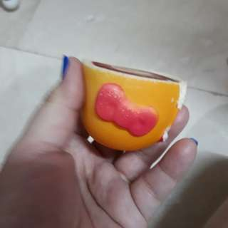 Hello kitty squishy cup as it is .used