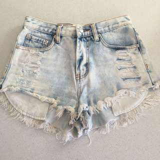 Light wash denim distressed shorts