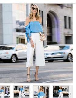 Blouse off shoulder and white pants