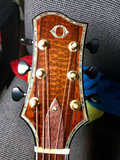 Custom Olson Guitar with Tiger Myrtle back side with Redwood top