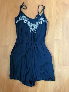 Navy embroidered floral romper with cross back details