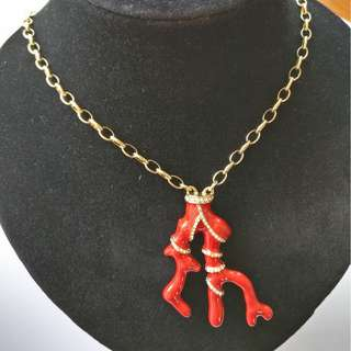 Large coral pendant/brooch with brilliant rounds gold-plated necklace