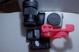 Sony a6000 , sigma 30mm dcdn f1.4 ,  2 battery , silicon case