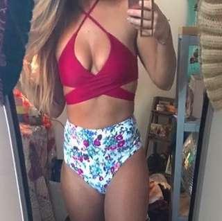 High waisted bikini with cross over top. Hygiene strip intact. Brand new