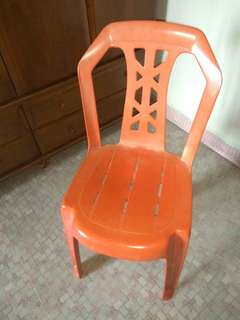 Solid red plastic chair